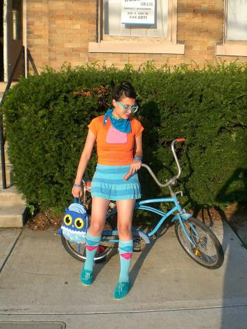 Female hipster with bike by Lorena Cupcake